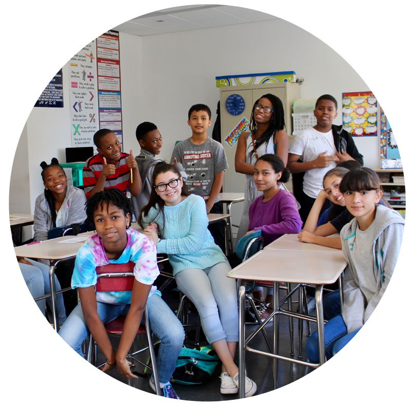 a classroom of students poses and gives thumbs up | High Jump Chicago